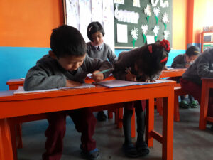 Students learning to write in Darjeeling, India