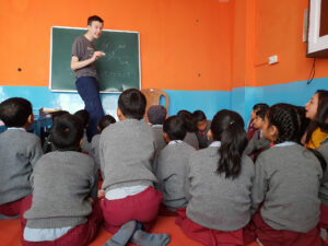 A volunteer teaching history in the Himalayas
