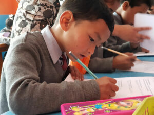 Reading and writing in School Aid India