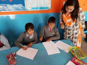 Teachers in India teaching English
