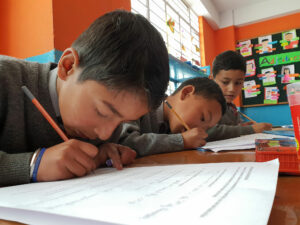 Indian students completing English homework