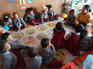 Group of children in India sat in a circle