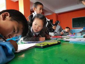 School Aid India students sharing work