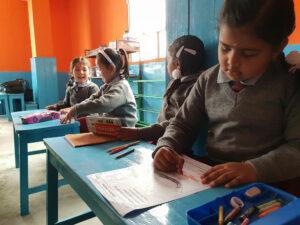 Schoolchild colouring in