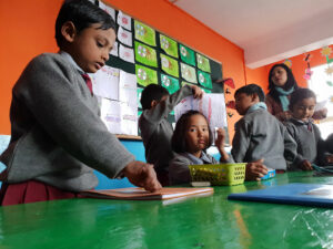 Proud children show their work to the teacher