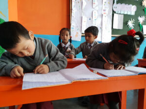 A group of children studying together in India