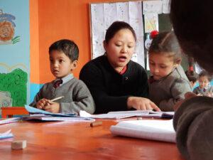 Schoolchildren in India with a teacher