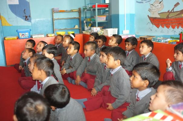 Children in India listening to the teacher