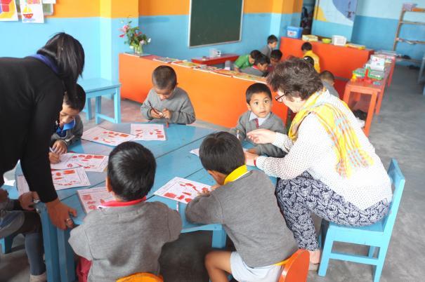 Volunteers teaching children in the Himalayas